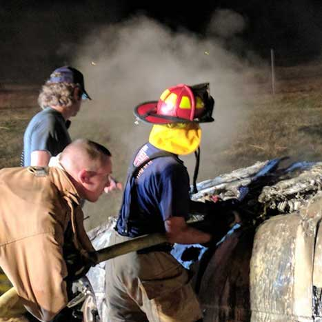 Weir firefighters extinguishing a car engine fire