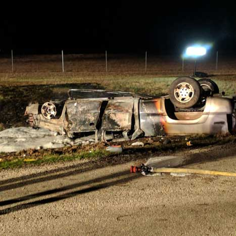 Overturned vehicle that caught fire