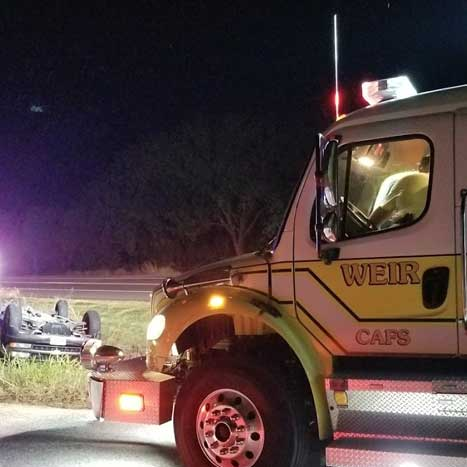 Weir engine on scene of overturned vehicle